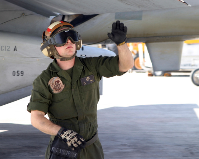 March 20, 2007, Lance CPL. Corey Cummins, an engine mechanic with Marine Tactical Electronic Warfare Squadron  (VMAQ-1), inspects a wing of an EA-6B Prowler during a preflight operations check on Asad Air Base, Iraq.  VMAQ-1 is deployed as a part of MNF-W in support of Operation Iraqi Freedom in the Anbar province of Iraq to develop the Iraqi Security Forces, facilitate the development of official rule of law through democratic reforms and continue the development of a market based economy centered on Iraqi reconstruction. (U.S. Marine Corps photo by Lance CPL. Michael L. Haas) (Released)