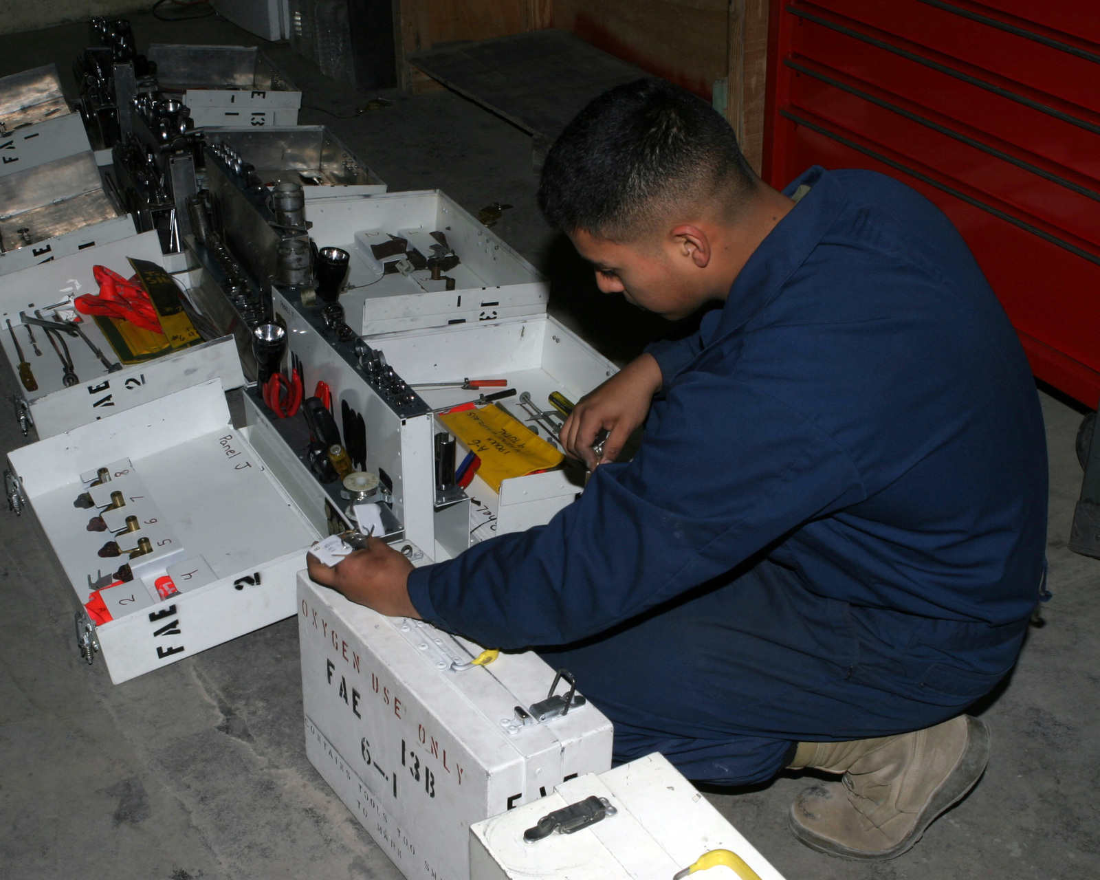 March 20, 2007, Lance CPL. Sergio Aquino, a seat mechanic with Marine Tactical Electronic Warfare Squadron  (VMAQ-1), conducts a tool accountability check in the Power line shop at Asad Air Base, Iraq.  VMAQ-1 is deployed as a part of MNF-W in support of Operation Iraqi Freedom in the Anbar province of Iraq to develop the Iraqi Security Forces, facilitate the development of official rule of law through democratic reforms and continue the development of a market based economy centered on Iraqi reconstruction. (U.S. Marine Corps photo by Lance CPL. Michael L. Haas) (Released)