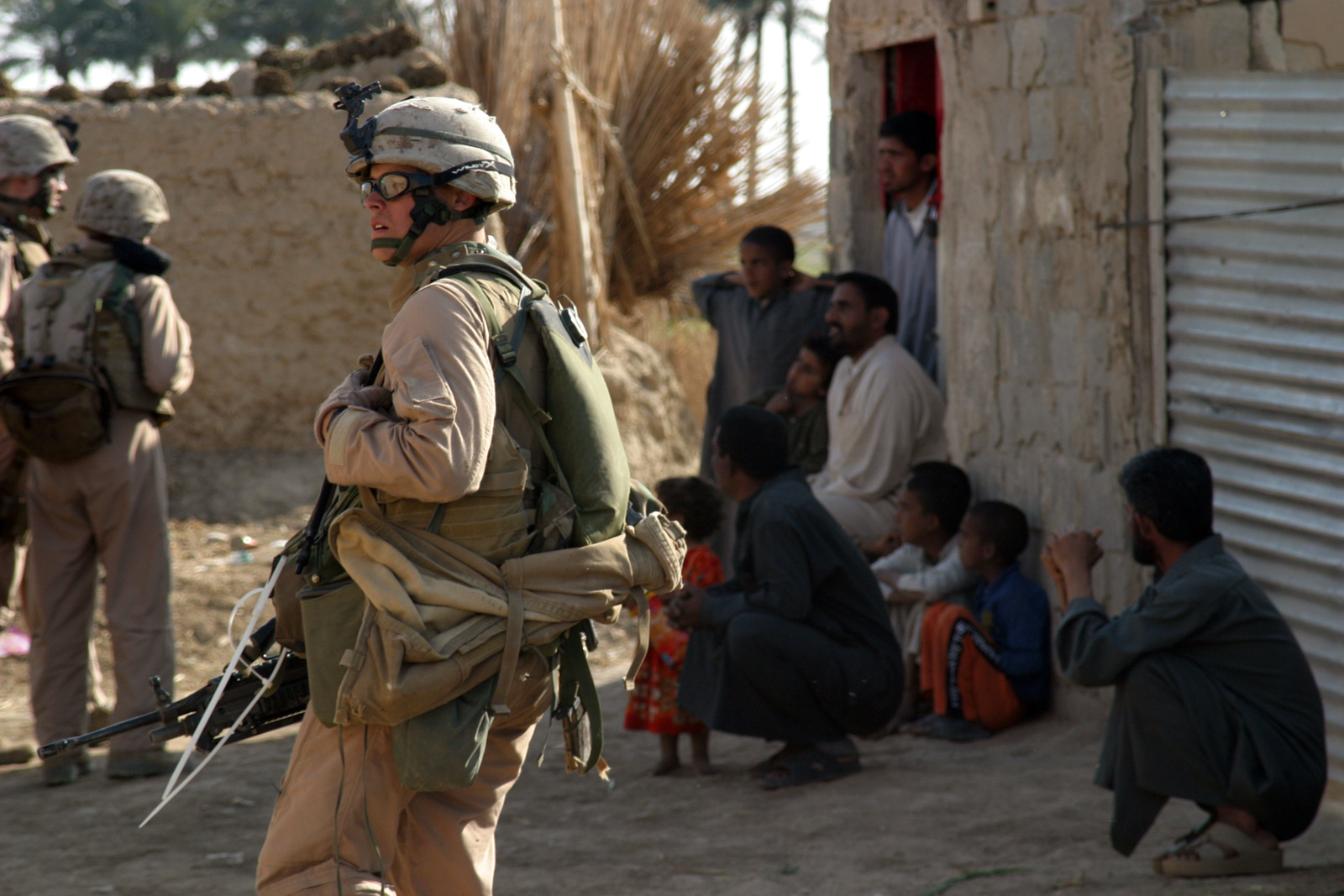 U.S. Marien Corps Lance CPL. Ian M. Taylor from Port Orchard, Wash. with 3rd Platoon, E Company, 2nd Battalion, 7th Marines patrols past some Iraqi civilians as he searches the surrounding area for Anti Iraqi Force activity during Operation Zaidon II on March 23, 2007. Task Force 2nd Battalion, 7th Marines is conducting Operation Zaidon II in Zaidon, Iraq to clear the city of Anti Iraqi Forces and deny them further use of the area in the future. Regimental Combat Team 6 is deployed with Multi National Forces-West in support of Operation Iraqi Freedom in the Anbar Province of Iraq to develop Iraqi Security Forces, facilitate the development of official rule of law through democratic...