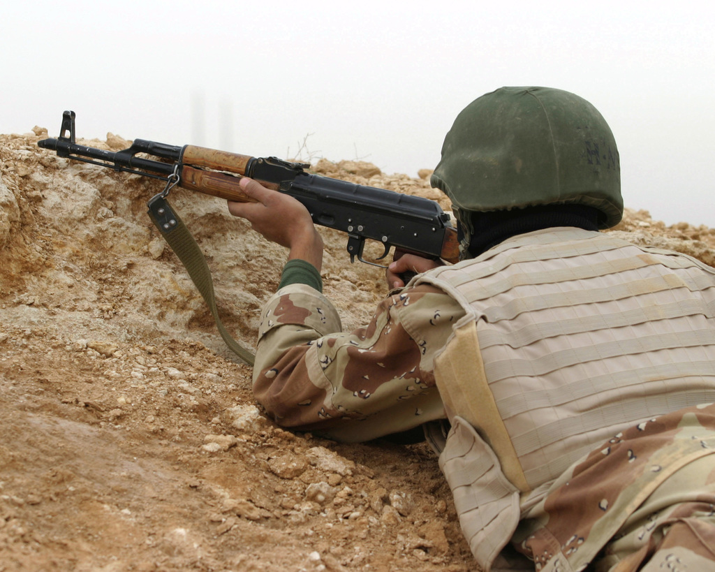 An Iraqi Army Soldier in the School of Infantry (SOI) simulates setting an ambush during a practice exercise at Camp Yasser on Al Asad Air Base, Iraq on March 24, 2007. SOI is a ten day training school that teaches advanced fighting techniques and tactics to new Iraqi Army Soldiers before they report to their battalions. 2nd Battalion 7th Iraqi Army Division Military Transition Team is deployed as a part of MNF-W in support of Operation Iraqi Freedom in the Anbar province of Iraq to develop the Iraqi Security Forces, facilitate the development of official rule of law through democratic government reforms and continue the development of a market based economy centered on Iraqi...