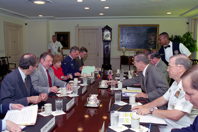 The Honorable Donald H. Rumsfeld (right, center), U.S. Secretary of Defense, attends a meeting with Andre Flahaut (left, center), Belgian Minister of Defense, at the Pentagon, Washington, D.C.,  Jun. 18, 2001.  OSD Package No. P07-0060 (PHOTO by Helene C. Stikkel) (Released)