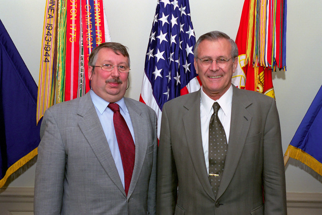 The Honorable Donald H. Rumsfeld (right), U.S. Secretary of Defense, poses for a picture with Andre Flahaut, Belgian Minister of Defense, at the Pentagon, Washington, D.C.,  Jun. 18, 2001.  OSD Package No. P07-0060 (PHOTO by Helene C. Stikkel) (Released)
