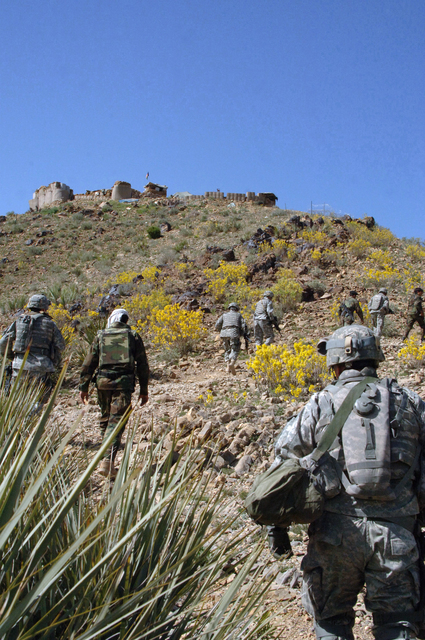 U.S. Army Soldiers from task force fury walk back to border checkpoint 7 in the Tirzaye district of the Khowst province of Afghanistan March 27, 2007. (U.S. Army photo by STAFF SGT. Isaac A. Graham) (Released)