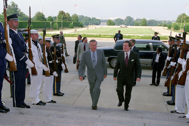 The Honorable Donald H. Rumsfeld (left), U.S. Secretary of Defense, escorts George Robertson, Barron Robertson of Port Ellen, North Atlantic Treaty Organization (NATO) Secretary General, through an Honor Cordon at the River Entrance of the Pentagon, Washington, D.C., Jun. 20, 2001. OSD Package No. P07-0065 (PHOTO by Helene C. Stikkel) (Released)