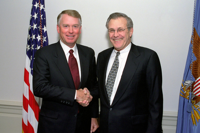 The Honorable Donald H. Rumsfeld (right), U.S. Secretary of Defense, poses for a picture with Dan Quayle, former Vice President of the United States, during a visit to the Pentagon, Washington, D.C., Feb. 27, 2001. OSD Package No. A07D-00021 (PHOTO by Robert D. Ward) (Released)