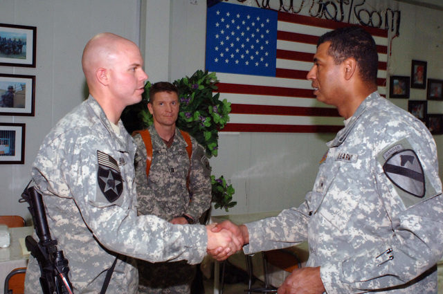 U.S. Army SGT. Christopher Evans (left), from the Engineer Fusion Cell, 2nd Brigade Special Troops Battalion, 2nd Infantry Brigade Combat Team (BCT), 2nd Infantry Division (ID), greets Brig. GEN. Vincent Brooks, Deputy Commanding General, Support, 1ST Cavalry Division, at Forward Operating Base Loyalty Dining Facility.  Brig. Gen Brooks is visiting to gain first hand knowledge of the construction of a new helipad and renovation of barracks as well as to discuss support issues with key leaders. (U.S. Army PHOTO by STAFF SGT. Bronco Suzuki) (Released)