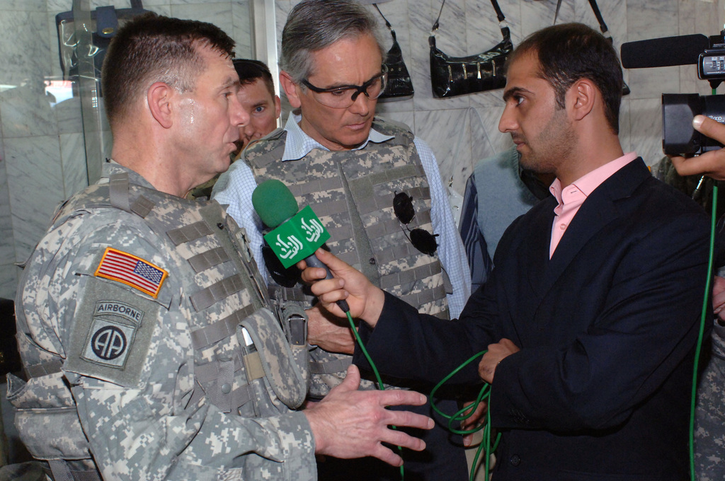 U.S. Army MAJ. GEN. William Caldwell (left), CHIEF Spokesman for Multi-National Forces Iraq, speaks to the Iraqi media at a leather store, in the Zafaraniyah area.  He is visiting the 2nd Battalion, 17th Field Artillery Regiment, 2nd Infantry Brigade Combat Team (BCT), 2nd Infantry Division area of operations in Zafaraniyah, to gain first-hand knowledge of the current security situation and initiatives aimed at increasing security, economic prosperity and governmental involvement.   (U.S. Army PHOTO by STAFF SGT. Bronco Suzuki) (Released)