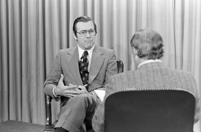Secretary of Defense Donald Rumsfeld talks to Mr. Jim Clark from WMAL-TV, Baltimore, Md., during an interview at the Pentagon studio in Washington, D.C., on Nov. 4, 1976. OSD Package D-1998-OSD-76-110015 (PHOTO by Ron Hall, CIV) (Released)