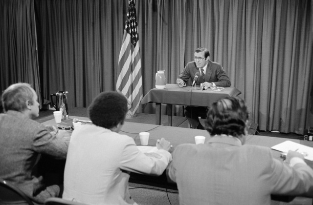 """U.S. Secretary Defense (SECDEF) The Honorable Donald H. Rumsfeld (background), is interviewed by a panel from the CBS Television and Radio News program""""Capital Cloakroom""""at the Pentagon Studio in Washington, D.C. on Oct. 6, 1976. OSD Package D-1998-OSD-76-100010 (PHOTO by Robert D. Ward) (Released)"""