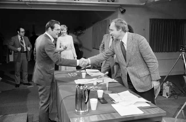 """U.S. Secretary Defense (SECDEF) The Honorable Donald H. Rumsfeld (foreground right), is greeted by a member of the CBS Television and Radio News program""""Capital Cloakroom""""as he arrives for a panel interview at the Pentagon Studio in Washington, D.C. on Oct. 6, 1976. OSD Package D-1998-OSD-76-100010 (PHOTO by Robert D. Ward) (Released)"""