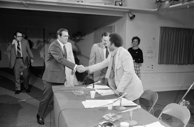 "U.S. Secretary Defense (SECDEF) The Honorable Donald H. Rumsfeld (foreground right), is greeted by a member of the CBS Television and Radio News program""Capital Cloakroom""as he arrives for a panel interview at the Pentagon Studio in Washington, D.C. on Oct. 6, 1976. OSD Package D-1998-OSD-76-100010 (PHOTO by Robert D. Ward) (Released)"