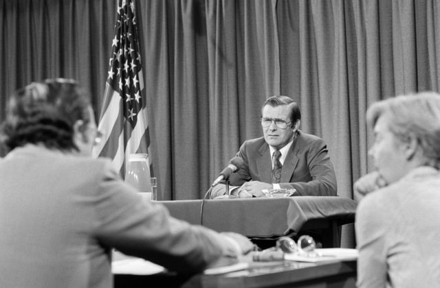 """U.S. Secretary Defense (SECDEF) The Honorable Donald H. Rumsfeld, is interviewed by a panel from the CBS Television and Radio News program""""Capital Cloakroom""""at the Pentagon Studio in Washington, D.C. on Oct. 6, 1976. OSD Package D-1998-OSD-76-100010 (PHOTO by Robert D. Ward) (Released)"""
