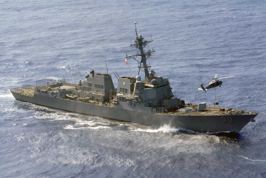 The U.S. Navy Arleigh Burke Class Guided Missile Destroyer USS CHAFEE (DDG 90) participates in a vertical replenishment on April 12, 2007, with a Military Sealift Command Supply Class Fast Combat Support Ship (right) USNS RAINIER (T-AOE 7) SH-60 Seahawk helicopter, while underway with the Nimitz Carrier Strike Group in the Pacific Ocean in support of operations in the U.S. Central Command (USCENTCOM) Area of Responsibility. (U.S. Navy photo by Mass Communication SPECIALIST SEAMAN Joseph Pol Sebastian Gocong) (Released)