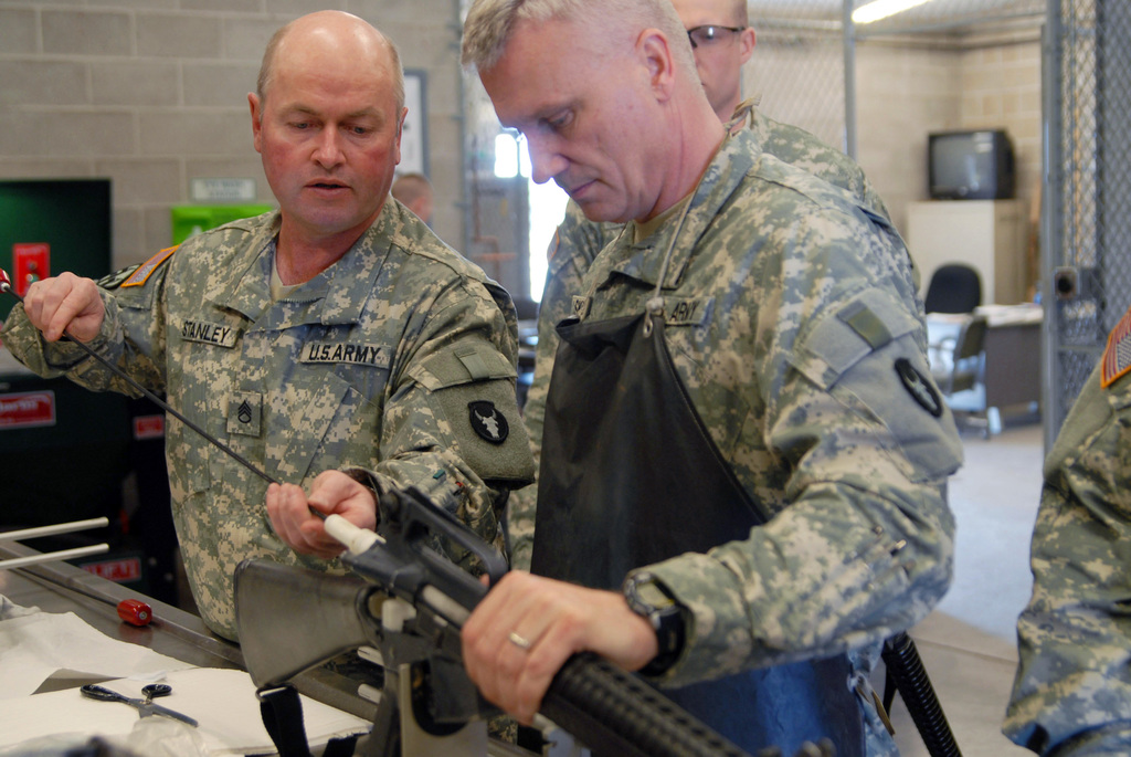 The U.S. Army soldiers competing for the honor of Soldier of the Year, from the Minnesota National Guard (MNARNG), clean their weapons after completing the marksmanship portion of the competition. (U.S. Army PHOTO by STAFF SGT. Daniel Ewer) (Released)