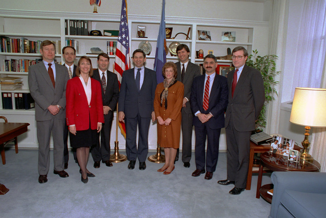 Paul Wolfowitz, center in blue tie, Under Secretary of Defense for Policy, poses for a photograph with members of the Office of the Secretary of Defense Cables and Office of the Secretary of Defense Protocol at the Pentagon, Washington, D.C., on Jan. 7. 1993. Package No. A07D-00085 (DOD photo by Robert D. Ward) (Released)