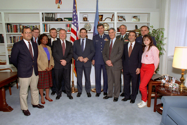 Paul Wolfowitz, center wearing blue tie, Under Secretary of Defense for Policy, poses for a photograph with Office of the Secretary of Defense Cables and Office of the Secretary of Defense Protocol personnel at the Pentagon, Washington, D.C., on Jan. 7. 1993. Package No. A07D-00085 (DOD photo by Robert D. Ward) (Released)