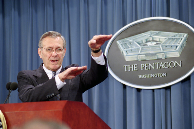The Honorable Donald H. Rumsfeld, left, U.S. Secretary of Defense, speaks to the press about the mid-air collision between a U.S. Navy EP-3E Aries II surveillance aircraft and a Chinese F-8 fighter jet during a briefing at the Pentagon, Washington, D.C., on April 13, 2001. Package No. A07D-00082 (DOD photo by Robert D. Ward) (Released)