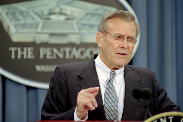 The Honorable Donald H. Rumsfeld, left, U.S. Secretary of Defense, talks to the press about the mid-air collision between a U.S. Navy EP-3E Aries II surveillance aircraft and a Chinese F-8 fighter jet during a briefing at the Pentagon, Washington, D.C., on April 13, 2001. Package No. A07D-00082 (DOD photo by Robert D. Ward) (Released)