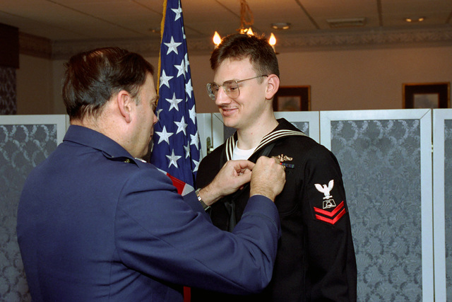 U.S. Air Force MAJ. GEN. John P. Jumper, left, presents a Navy Good Conduct Medal to a U.S. Navy mess personnel Sailor from the Office of the Secretary of Defense during an award ceremony at the Pentagon, Washington, D.C., on Jan. 4, 1993. Package No. A07D- 00083 (DOD PHOTO by Robert D. Ward) (Released)