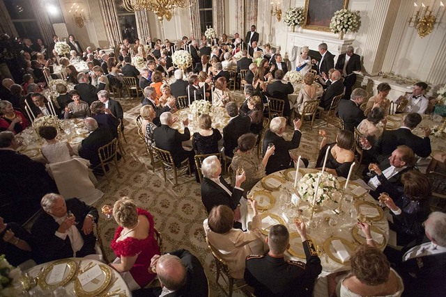 President George W. Bush Toasts Her Majesty Queen Elizabeth II of Great Britain during a State Dinner