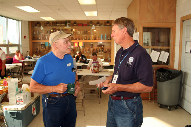 [Severe Storms, Tornadoes, and Flooding] Mullenville, KS  May 19, 2007 - Greensburg resident Jack Carson talks with FEMA Disaster Assistance Employee Bob Harting about his housing needs. The Mullenville shelter where Jack has lived since an F5 tornado damaged his home is scheduled to close in a few days.  Photo by Greg Henshall / FEMA