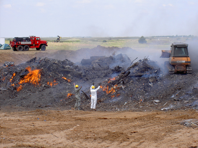 "Tornado - Greensburg, Kan. , May 19, 2007 -- The ""burn pit"" operation for Greensburg Kansas tornado debris. Vegetative and other combustible debris from destruction caused by an EF-5 tornado was burned under close supervision at a temporary landfill.  FEMA/Crystal Payton"