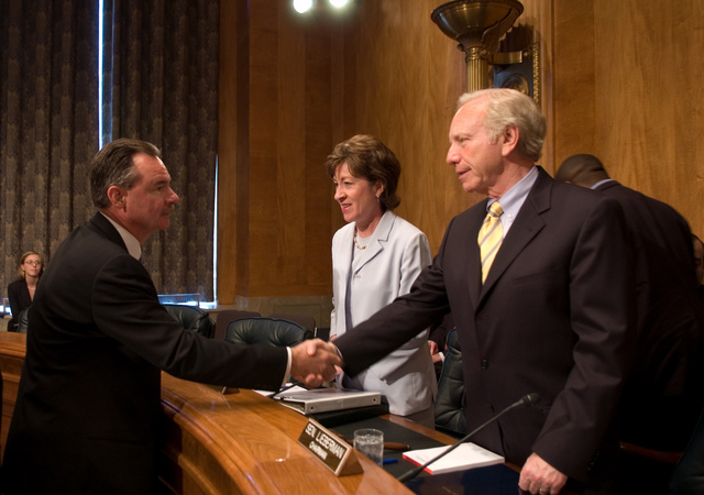 Washington, DC, May 22, 2007 -- FEMA Administrator R. David Paulison shakes hands with Senator Joseph Lieberman who is Chairman of the Committee on Homeland Security and Governmental Affairs, at their Hearing Room.  Mr. Paulison then gave testimony on how FEMA has prepared for the upcoming Hurricane season.  Center is Senator Susan Collins the Current Ranking Member of the Committee on Homeland Security and Governmental Affairs, FEMA/Bill Koplitz