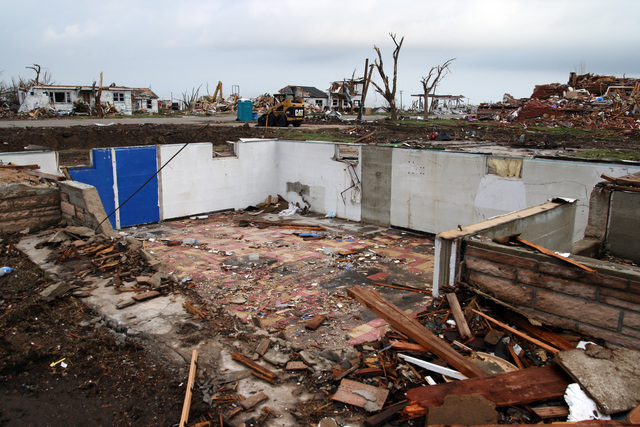 [Severe Storms, Tornadoes, and Flooding] Greensburg, KS  May 23, 2007 - A basement is all that's left of a home in the middle of town.  Most of the buildings that were not blown away by the May 4 tornado will have to be torn down.  FEMA is paying seventy-five percent of the removal costs.  Photo by Greg Henshall / FEMA