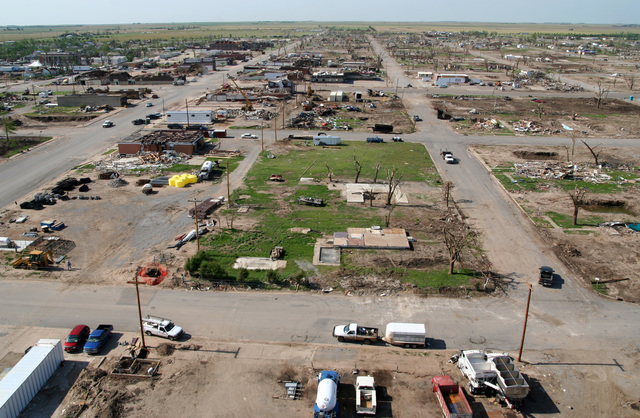[Severe Storms, Tornadoes, and Flooding] Greensburg, KS,  June 4, 2007 -- One month ago Greensburg was demolished by an F5 tornado.  Demolition crews have hauled out enough debris to fill a twelve-story office building the size of a football field. FEMA is paying seventy five percent of the cleanup costs.  Photo by Greg Henshall / FEMA