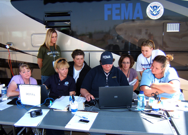 [Severe Storms, Tornadoes, and Flooding] Greensburg, KS,  June 9, 2007 -- New local hires are shown by Disaster Assistance Employees (DAE's) Donna Johnson (third from left) and Jeri Zen(fifth from left) some of the FEMA processes they will have to learn.  The new employees are: (l to r):  Julie Hillshafer, Jamie Maledon, Karen Sherman, Cindy McMurry, Toryn Stottenberg, and Dodie Kipp.  Photo by Greg Henshall / FEMA