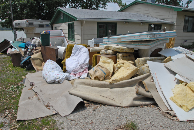 [Severe Storms and Flooding] Big Lake, MO, 6-16-07 -- Flood water damaged household belongings lay piled up ready to be hauled to the dump. Moldy flood damaged belongings, drywall, and insulation must be removed for health issues.  FEMA has aid available to victims that received flood damage under FEMA's Individual Assistance Program.  Marvin Nauman/FEMA photo
