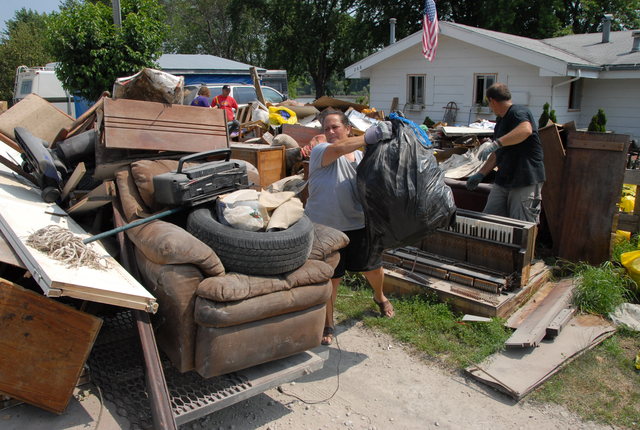 [Severe Storms and Flooding] Big Lake, MO, 6-16-07 -- Shari Verneer and Jay Morehead load flood damaged household items onto a trailer they are taking to the dump.  Marvin Nauman/FEMA photo