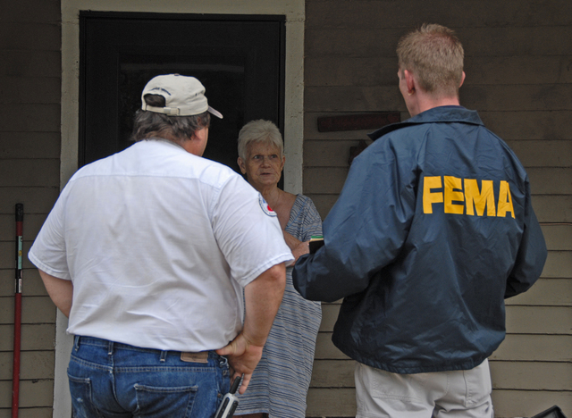 [Severe Storms and Flooding] Rosendale, MO, 6-30-07 -- Rosendale Emergency Manager Joe Thomas and FEMA Community Relations Specialist Chad McCormick talk with Margaret Nickels whose home was flooded.  Community Relations Specialists are in the flood damaged area to let people know about registering for FEMA aid that may be available to them under the Individual Assistance Program. Marvin Nauman/FEMA photo
