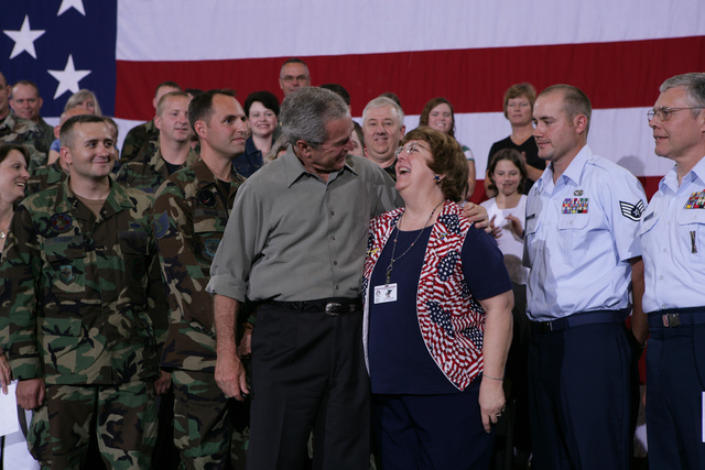 President George W. Bush Embraces Joy Enders during a Fourth of July Visit with Members of the West Virginia Air National Guard 167th Airlift Wing and their Family Members in Martinsburg, West Virginia