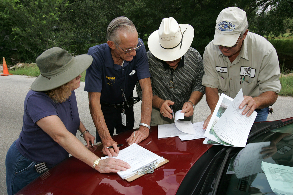[Severe Storms, Tornadoes, and Flooding] Kingsland, TX, July 12, 2007 -- FEMA Public Assistance specialist Damon Naumann inspects damaged local infrastructure with Pat Hanger of the state and County Commissioner Johnie B. Heck to compile a Preliminary Damage Assessment report to verify if Llano County will be eligible for federal assistance. Bob McMillan/ FEMA Photo