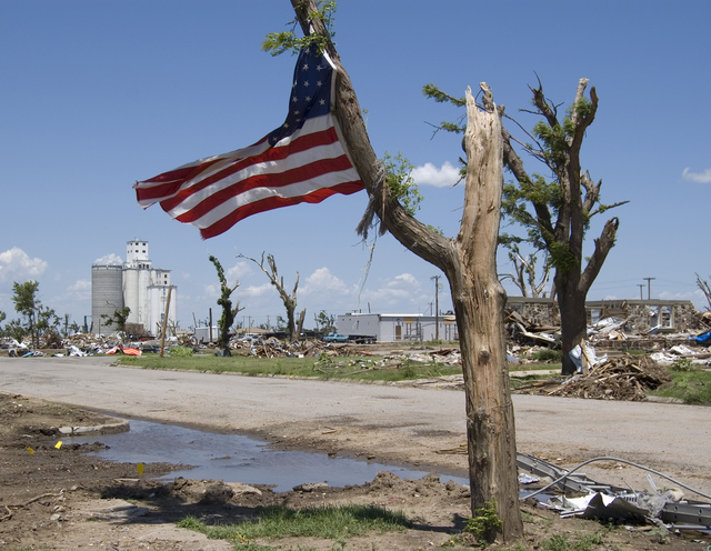 [Severe Storms, Tornadoes, and Flooding] Greensburg, KS, 7/16/2007 --  Residents of Greensburg, KS which was destroyed by an F5 tornado put this American flag on one of the few remaining trees. FEMA is in Greensburg assisting with the rebuilding.  Photo by Tim Tyson/FEMA