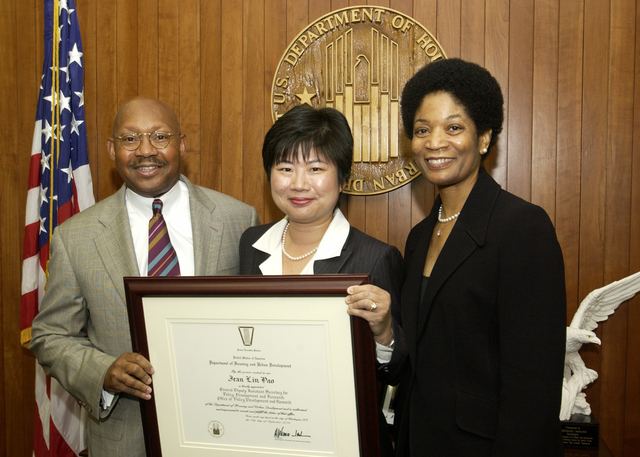 Secretary Alphonso Jackson with Jean Lin Pao - Jean Lin Pao, General Deputy Assistant Secretary for Policy Development and Research in the Office of Policy Development and Research, receiving appointment certificate from Secretary Alphonso Jackson, HUD Headquarters