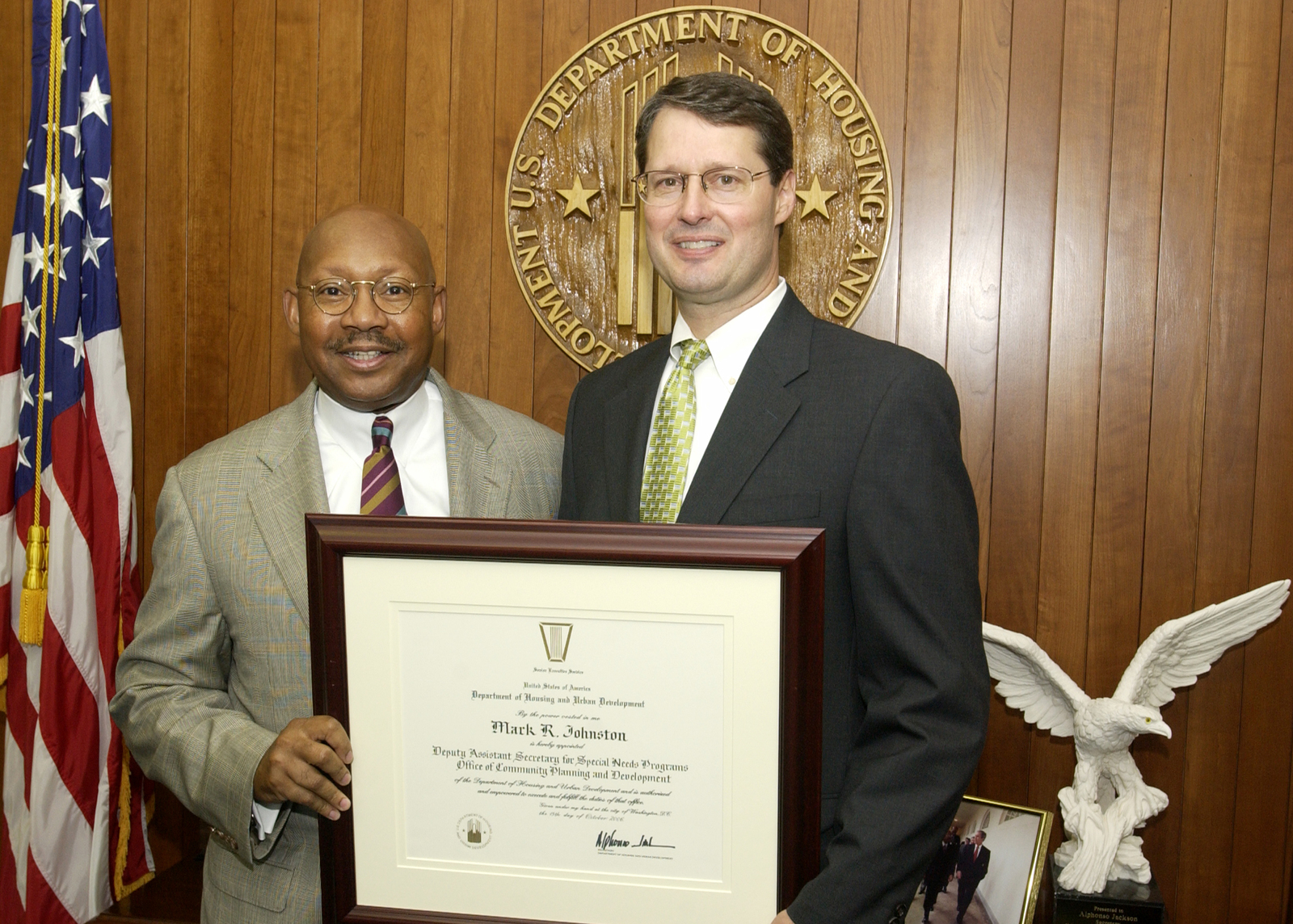 Secretary Alphonso Jackson with Mark Johnston - Mark Johnston, Deputy Assistant Secretary for Special Needs Programs in the Office of Community Planning and Development, receiving appointment certificate from Secretary Alphonso Jackson, HUD Headquarters