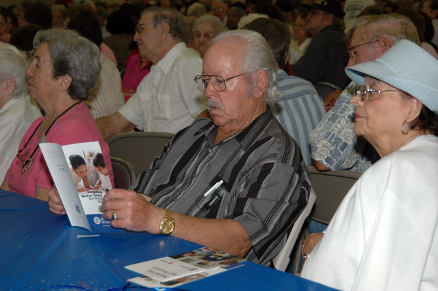 [Hurricane Katrina] Port Barre, LA, 07/25/2007 -- Louvana and Manuel Thibodeaux are attendees at a Hurricane Preparedness presentation presented by FEMA in cooperation with the St Landry Parish Sheriff's Office.  Approximately 500 senior citizens recieive material and listen to a FEMA spoksesperson discuss preparedness during this seminar. Photo Manuel Broussard/FEMA.