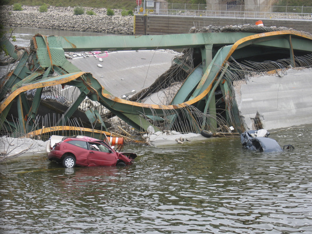 Minneapolis, MN, August 5, 2007 --  Cars and roadway litter the river where the I-35 bridge collapsed in Minneapolis.  FEMA/Todd Swain