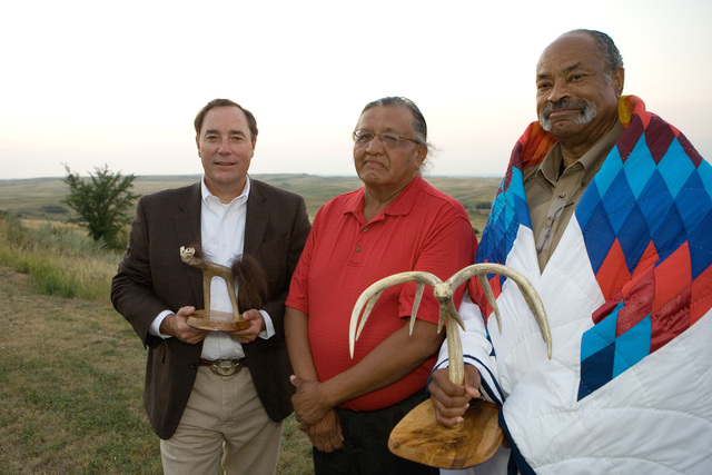 Standing Rock Reservation, ND,  August 6, 2007- Standing Rock Sioux Tribe  Council Representative, Jesse Taken Alive (center), honors FEMA Region VIII Regional Administrator, Robert Flowers (left) and FEMA Tribal Region VIII Tribal Liaison Officer, Scott Logan (right), during the  ten year commemoration of the FEMA Tribal Relations policy. Andrea Booher/FEMA