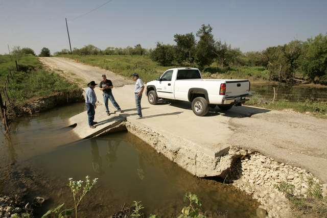 [Severe Storms, Tornadoes, and Flooding] Albany, TX, August 14, 2007 -- Public Assistance Specialist Phil Brown surveys damage with County Commissioner Jimmy Brook and Tom Hardin while on a Preliminary Damage Assessment tour of Shackelford County.  Bob McMillan/ FEMA Photo