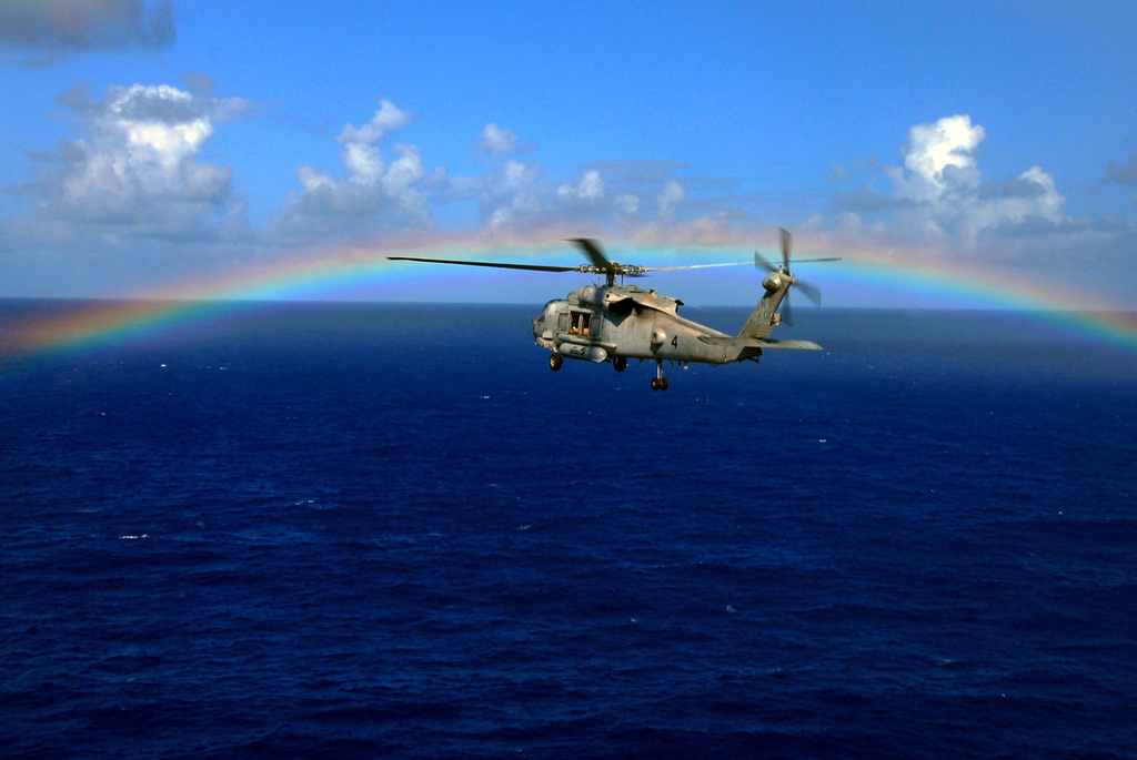 A U.S. Navy HH-60H Seahawk helicopter from Helicopter Anti-Submarine Squadron Eight (HS-8) flies through a rainbow on its way back to the Nimitz Class Aircraft Carrier USS JOHN C. STENNIS (CVN 74) during operations in the Pacific Ocean on Aug. 17, 2007. (U.S. Navy PHOTO by Mass Communication SPECIALIST 3rd Class Paul J. Perkins) (Released)