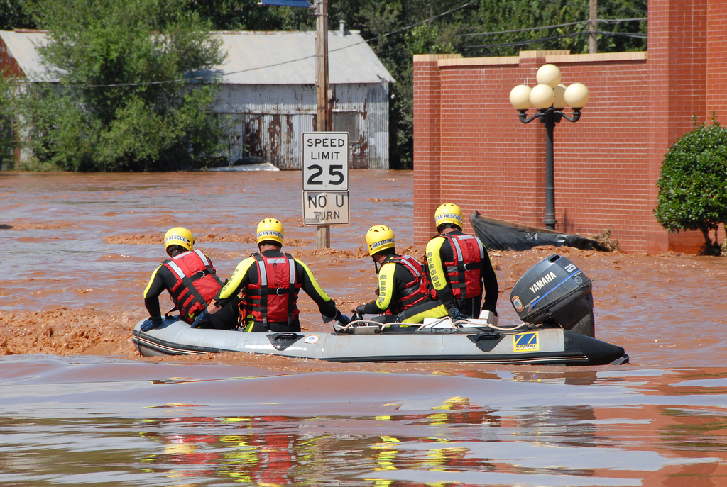 [Severe Storms, Tornadoes, and Flooding] Kingfisher, OK, August 19, 2007 -- A Rescue Boat searches for stranded people in downtown Kingfisher. People were rescued when flood waters rose and stranded them.  FEMA's Individual Assistance Program has grants and other aid available to help flood victims recover from floods.  Marvin Nauman/FEMA photo