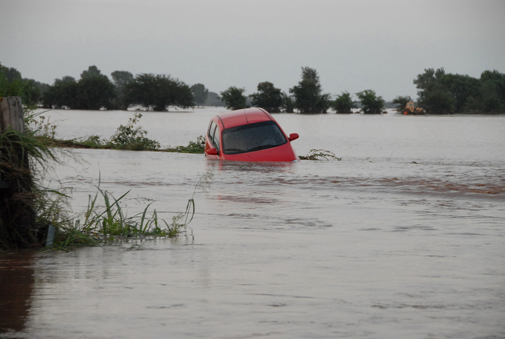[Severe Storms, Tornadoes, and Flooding] Kingfisher, OK, August 19, 2007 -- This red car was washed off the highway and it occupants had to be rescued when Tropical Storm Erin flooded the area. FEMA is in the area helping residents recover from the flooding.  Marvin Nauman/FEMA photo