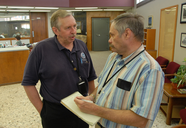 [Severe Storms, Tornadoes, and Flooding] Kingfisher, OK, August 20, 2007 -- Enid News & Eagle Reporter Robert Barron interviews FEMA PIO Charles Henderson about FEMA's role in the recovery efforts from the flooding in Kingfisher.  FEMA's Individual Assistance Program has grants and other aid available to help flood victims recover from floods.  Marvin Nauman/FEMA photo