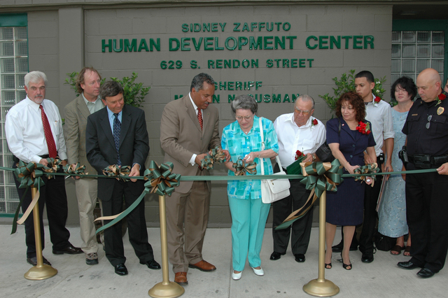 [Hurricane Katrina] New Orleans, LA, August 21, 2007 - - Members of the Federal Emergency Management Agency (FEMA), The Orleans Parish Sheriffs Department and members of the Zaffuto Family cut the ribbon during the dedication of the Sidney Zaffuto Human Development Center.  The training center is just one of the many FEMA rebuilding projects across the greater New Orleans area and Louisiana. Present from left at the dedication are Executive Director Michael Rentza, Louisiana Commission on Law Enforcement; FEMA Public Assistance Section Chief John Connolly; FEMA Louisiana Transitional Recovery Office Director Jim Stark; Orleans Parish Sheriff Marlin Gusman and Sidney Zaffuto family members. T