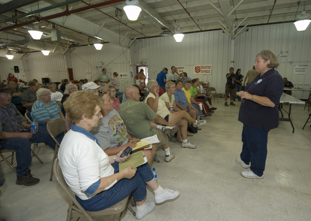 [Severe Storms and Flooding] Rushford, MN, August 27, 2007 -- FEMA employee, Diane Knight, talks to residents at a Disaster Recovery Center (DRC).  FEMA is working with individuals and state and local representatives to help them recover from the flood.  Photo by Patsy Lynch/FEMA