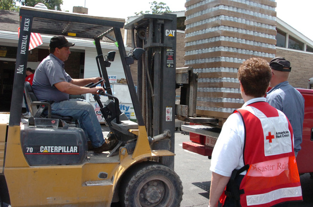 [Severe Storms, Flooding, and Tornadoes] Ottawa, Ohio, August 27, 2007 -- Putnam County Red Cross Board Chairwoman Jaqueline Urton watches another pallet of drinking water being unloaded at her Red Cross distribution point in Ottawa. Trinity United Methodist Church was a hub of activity as the Red Cross mobilized to assist local residents in responding to the North Central Ohio floods. Mike Moore/FEMA