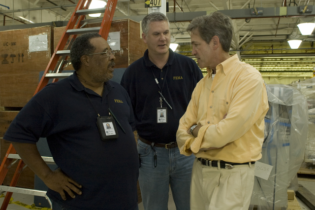 [Severe Storms and Flooding] Rushford, MN, August 28, 2007 -- Senator Norm Coleman, R-MN talks to FEMA employees Mack Gardner(l) and Charles Edward at the Disaster Recovery Center (DRC). FEMA is working with state and local representatives in Minnesota to help individuals recover from the recent floods.  Photo by Patsy Lynch/FEMA